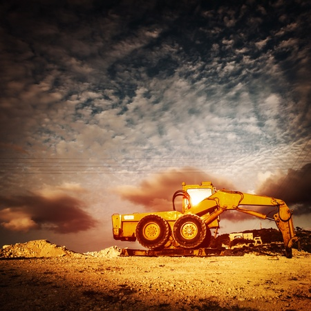 industrialized: Old excavator over sunset Stock Photo