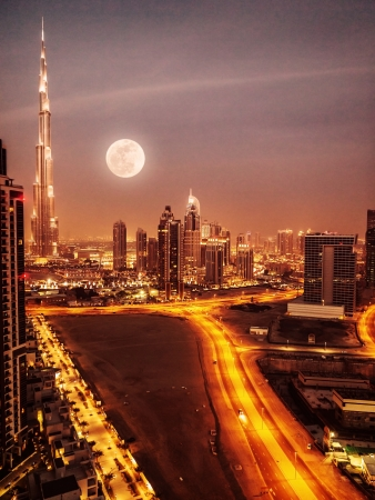 and scape: Dubai in moonlight, UAE, full moon, night scape in Dubai downtown, modern arabian architecture, middle east, illuminated city at night, luxury vacation  Stock Photo
