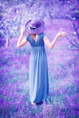 Dreamy, fine art photo of seductive woman in fairy garden, romantic girl in elegant long dress on purple lavender field, sensual nymph in the forest photo