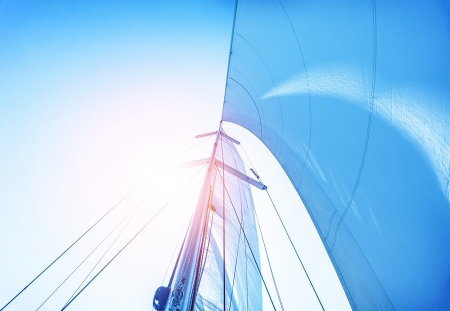 Closeup on sail on blue sky background, active lifestyle, cruise of dream, extreme water sport, summer holidays, yachting concept