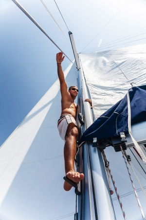 skipper: Cute sailor fix sail, active lifestyle, summer holidays, water journey, yachting sport, man on vessel, marine lifestyle