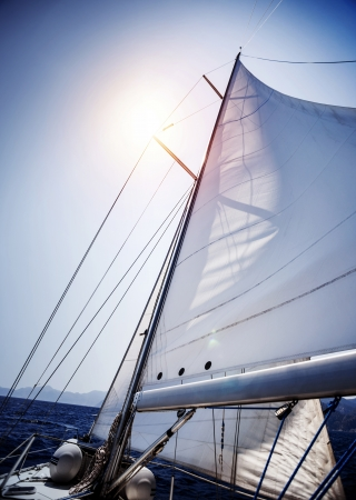 sailboat race: Sail of the yacht fluttering in the wind, summer adventure, sea cruise on sailboat, yachting sport, active lifestyle, holidays and vacation concept   Stock Photo