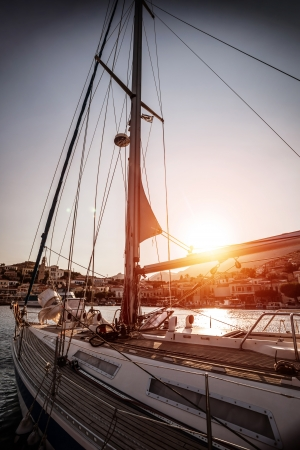 Luxury sailboat in sunset, old harbor in beautiful Europe city, water transport, sea cruise, summer vacation, travel and tourism concept photo