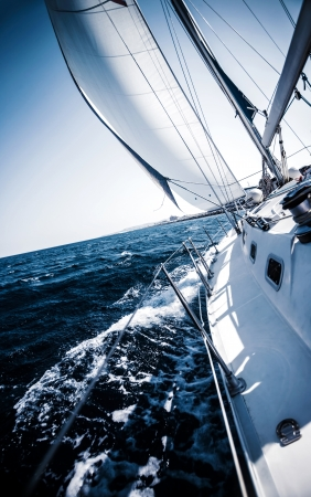 Sailboat in action, extreme sport, luxury water transport, summer vacation, cruise in the sea, active lifestyle, travel and tourism concept photo