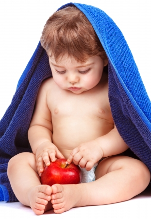 Sweet child discovering red fresh apple isolated on white background, enjoying ripe fruit, baby after bathing, healthy kids food concept  photo