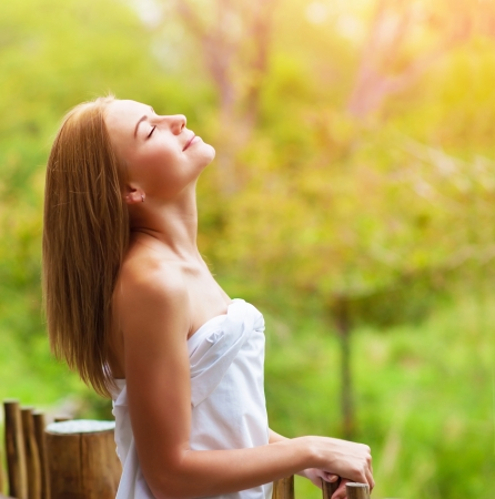 dacha: Closeup on beautiful calm woman enjoying nature on terrace in luxury cottage, spa resort, zen balance, summer vacation, harmony conception