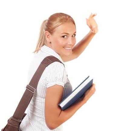 Gros plan sur la fille heureuse d'étudiant en s'éloignant et en agitant au revoir, isolé sur fond blanc, lycée, le temps d'apprendre, le concept de l'éducation Banque d'images
