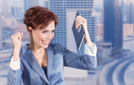 got: Closeup portrait of attractive happy business woman on city background, successful career, done deal, executive manager, business and success concept