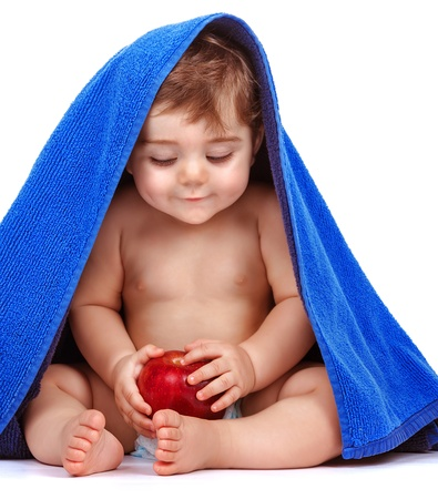 baby sit: Happy child with fresh fruit isolated on white background, cute baby boy covered with blue towel, happy and healthy lifestyle, toddler pampering, baby nutrition concept