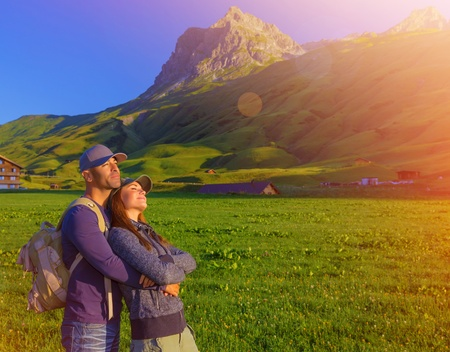 austrian village: Loving couple enjoying sunset in the mountains, Alps, Austrian mountain, summer adventure, active family, romantic trekking to Europe Stock Photo