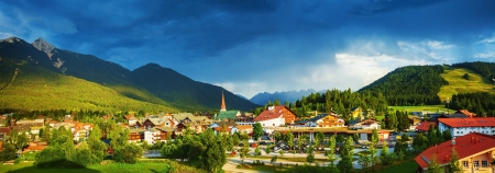 little town: Little town in the mountains, Europe, Austria, Seefeld, Alps, dark blue sky, beautiful buildings, traditional architecture, summer vacation concept