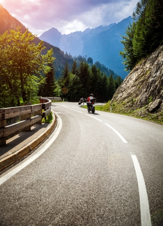 Bikers on mountainous race, curve road in Alpine mountains, Austria, Europe, extreme touring, happy lifestyle, travel and journey concept photo