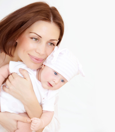 Newborn healthy infant with beautiful mom, enjoying family, new life, together at home, love and tenderness concept Stock Photo - 22349667