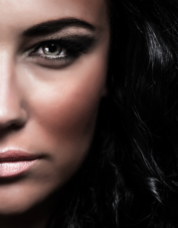supermodel: Closeup portrait of gorgeous glamourous woman, half of face, stylish makeup, fashionable lifestyle, black glossy hair, desire and passion concept