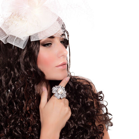 Closeup portrait of attractive female with dark curly hair isolated on white , bridal look, hat with veil, luxury ring, fashion concept Stock Photo - 22766115