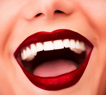 Sexy red glossy lips, model with fashion makeup, face part, beautiful white teeth, female laughing facial expression, glamor concept photo