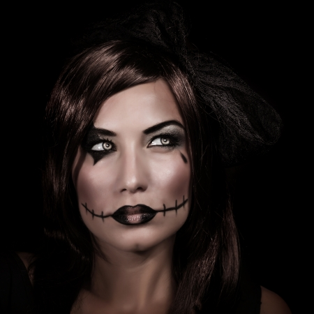 Scary woman portrait isolated on black , mystery night, terrifying makeup, spooky zombie, young witch, Halloween party concept photo