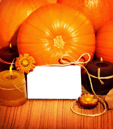 Thank you orange background, thanksgiving greeting card with pumpkin decorations and warm candle light, holiday still life with white copy space photo
