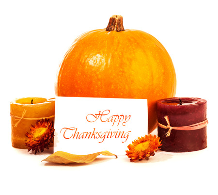 Traditional Thanksgiving day decoration isolated on white background, yellow gourd with candles and greeting card, autumn harvest holiday photo