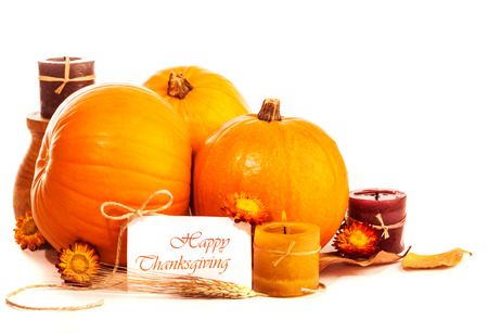 Thanksgiving day still life on isolated on white background, happy holiday, ripe orange gourds with candle and dry flowers, greeting card, harvest season concept photo