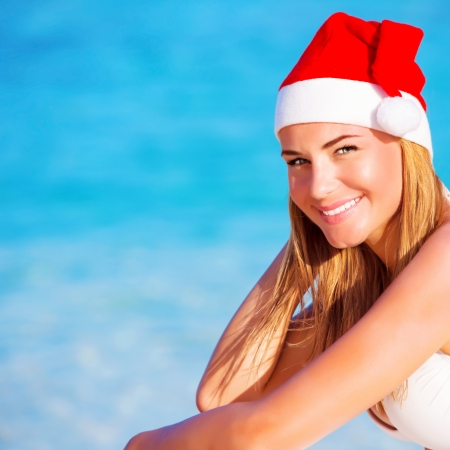 New Year vacation, happy blond girl enjoying Maldives, wearing red Santa hat, travel to exotic country on winter holidays