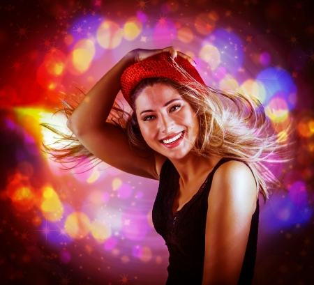 Portrait of happy dancing girl on pink glowing lights background, dance club, Christmas party, famous Dj, night performance concept photo
