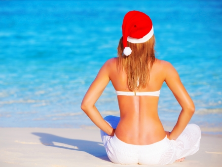 Blond woman celebrating New Year holidays on Maldive islands, enjoying exotic nature, sitting on the beach, luxury vacation concept photo