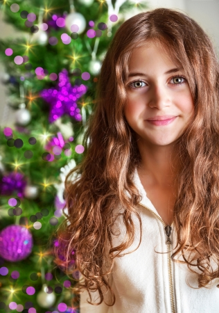 Closeup portrait of sweet teen girl on Christmas tree , New Year children party, happy wintertime holidays concept Stock Photo - 23848405