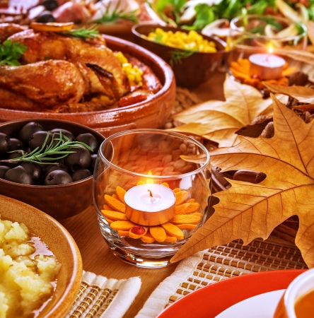 Thanksgiving day menu, traditional oven roasted chicken, different kind of tasty food, beautiful autumn decoration, festive meal concept photo