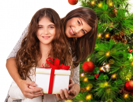 Closeup portrait of cheerful young family celebrating New Year holidays, receive present, happy Christmastime party, Merry Christmas concept photo