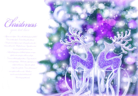 Abstract Christmas border, small glass reindeer decor in champagne glasses, Xmas tree with purple decoration, text space, greeting cars with congratulation photo