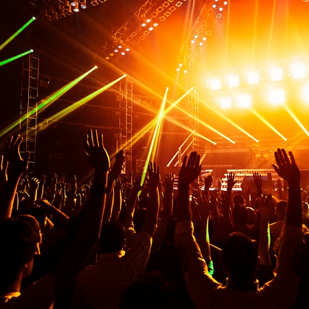 nightclubs: Photo of young people having fun at rock concert, active lifestyle, fans applauding to famous music band, nightlife, dj on the stage in the club, crowd dancing on dancefloor, night perfomance Stock Photo