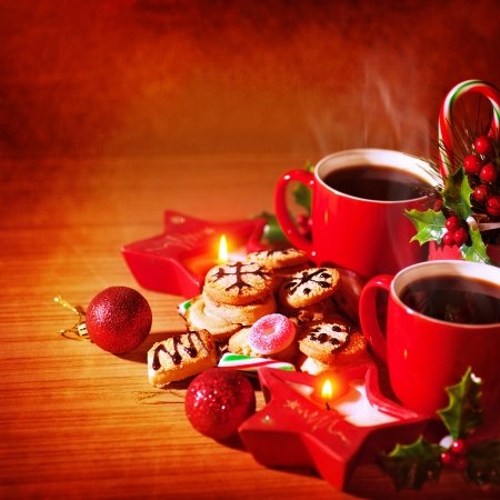 Closeup photo of festive Christmastime still life, tasty dessert, homemade cookie with mug of hot coffee, Christmas celebration concept photo