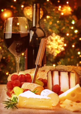 Christmas eve dinner, fine dining restaurant, romantic cheese and wine table, winter holidays celebration  photo