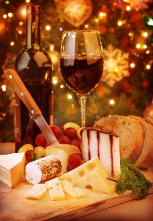 Christmas dinner at home, cheese and wine table setting, cozy atmosphere on Christmas eve   photo