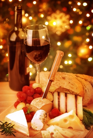 christmas atmosphere: Christmas table, festive food still life, romantic cheese and wine set up, Xmas party at home