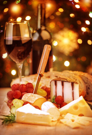 cheese slices: Closeup on festive dinner still life, red delicious wine with cheese, Christmas celebration, New Year party, winter holidays concept Stock Photo