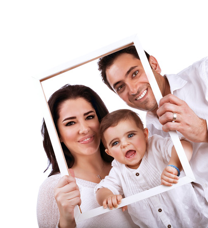 Happy family portrait isolated on white background, holding in hands frame, nice picture of adorable baby girl with parents photo