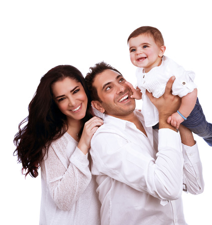 Playful young family isolated on white background, adorable baby girl with loving parents, healthy lifestyle, happiness and love concept