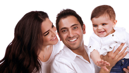Closeup portrait of young parents carrying sweet little child isolated on white background, happy arabic family, love concept