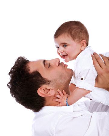 Happy father kissing baby daughter, isolated on white background, having fun indoors, young family, happiness and love concept photo