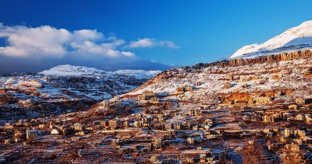 Beautiful landscape of mountainous town in winter, many cozy cottage, eco tourism, Faraya mountain in Lebanon, ski resort, wintertime holidays concept photo