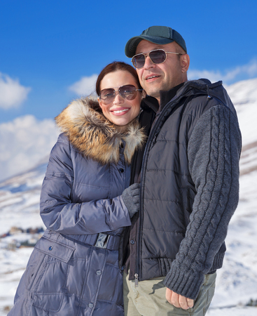 Portrait of cheerful family spending winter holidays in the mountains, romantic relationship, travel on Valentine day, wintertime vacation concept photo