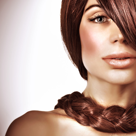 Closeup portrait of gorgeous young lady with beautiful long brown hair, natural haircare, stylish braid hairstyle, luxury hairdressing salon photo