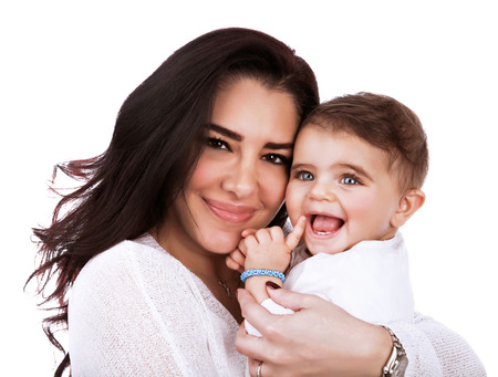 Closeup portrait of cute mother with daughter isolated on white background, young attractive woman hugging sweet adorable child, happy childhood concept photo
