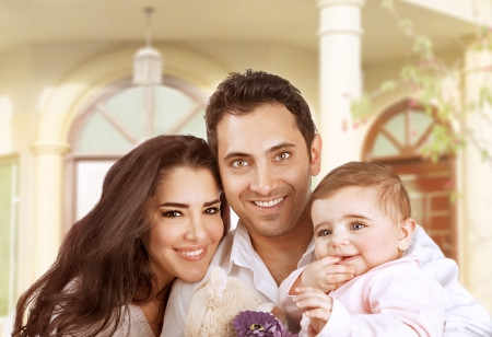 New family house, succesfull young parents with little baby having fun in country house, young cheerful owner of real estate, happy lifestyle concept  photo