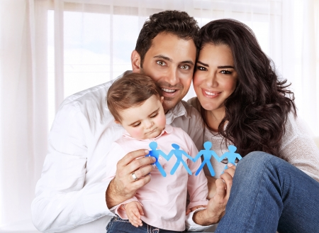 child protection: Portrait of sweet little child with mother and father at home, kid safety, people protection, creative education concept
