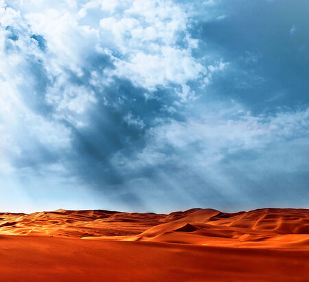 Beautiful landscape of Liwa desert, United Arab Emirates, Abu Dhabi, orange hot sand, blue cloudy sky, beauty of nature concept photo