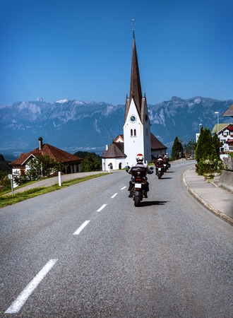 rout: Travelling of bikers along Alpine mountains, group of motorcyclists riding across mountainous town, extreme sport, active lifestyle, happy vacation concept