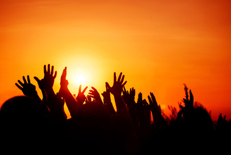 many people: silhouettes of hands up in the sky